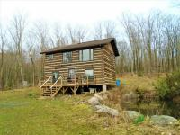 2 Storey Cabin + 182 Acres Adjacent to Crown Land on land for sale in Canada.